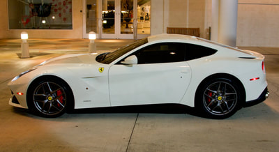 White Ferrari side view after detail