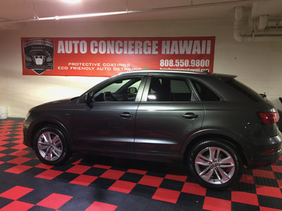 side view of gray Audi Q3 showing Auto Concierge Hawaii banner